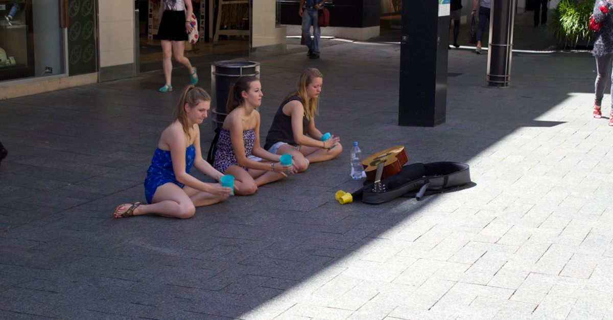 Busking with cups.