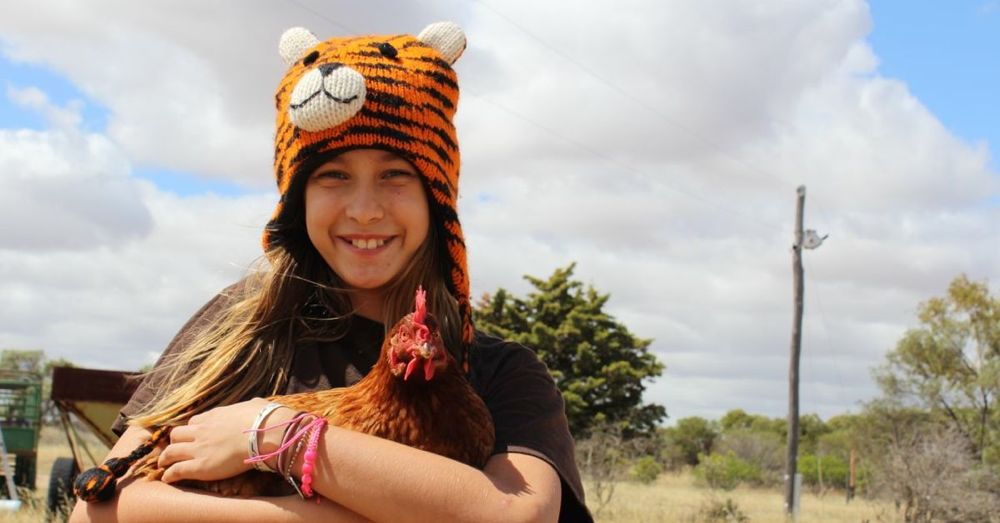 A girl and her chicken.