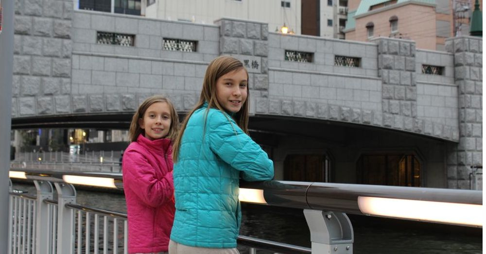 Girls on a bridge.