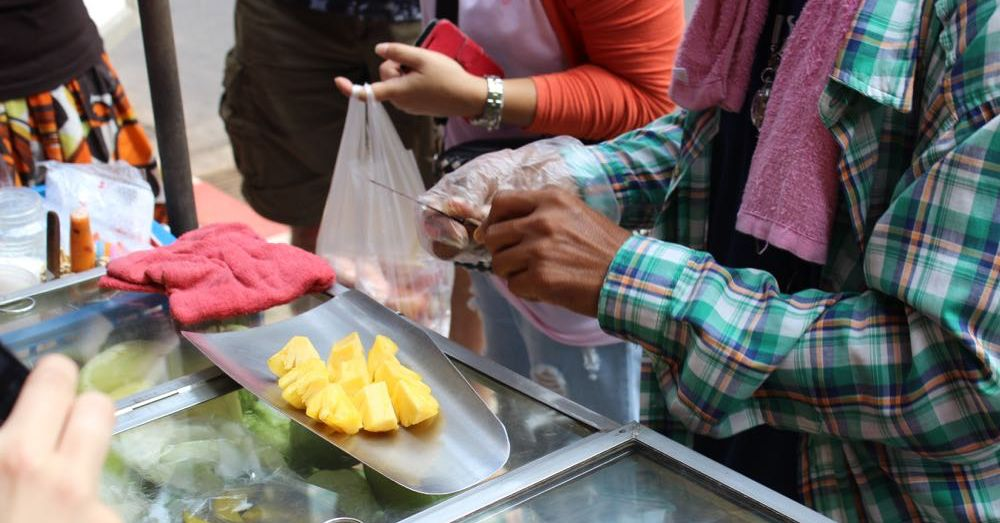 Cutting the fruit.