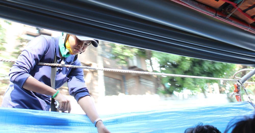 Taking tickets on the Khlong Saen Saep Express