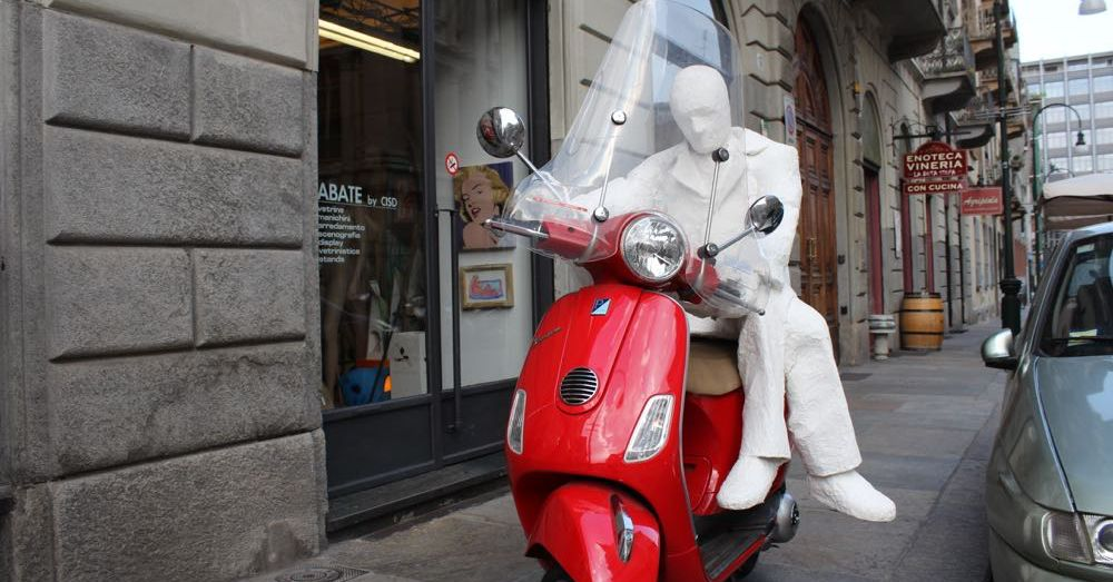 Statue on a Scooter