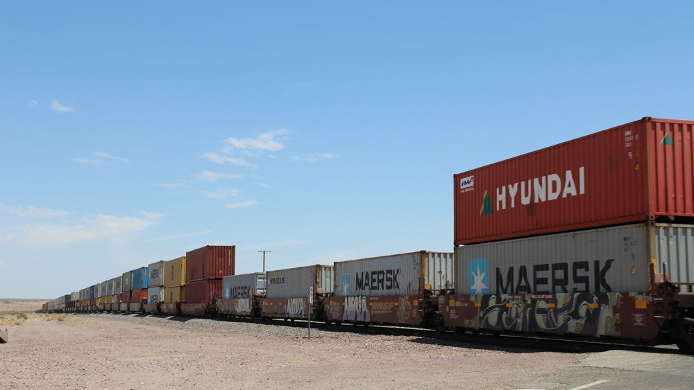 Stopped by a freight train along Route 66.