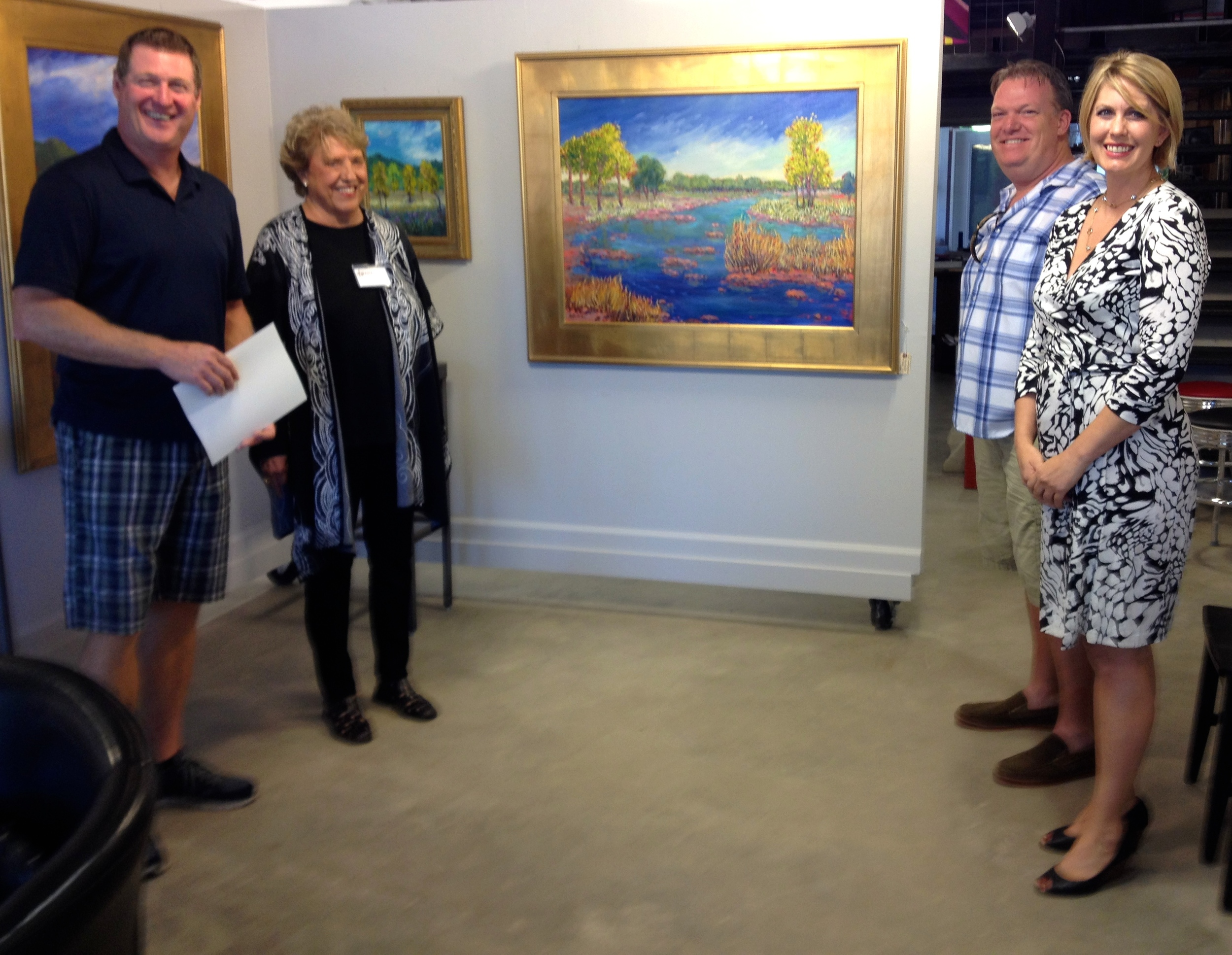 Russ Whitlock, Mary Bechtol, Matt Wigglesworth and Staci Almagor with the painting,  Quiet on the Pedernales , which is being auctioned for the benefit of the Friends of LBJ Nat'l Park. Bids are open until 9pm October 23rd. Check on the current top bid at www.TasteWineArt.com. Email your bids to susan@TasteWineArt.com