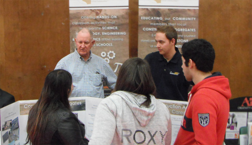 Warren Coalson and James DeCarolis speaking to high school students about careers in construction aggregates.