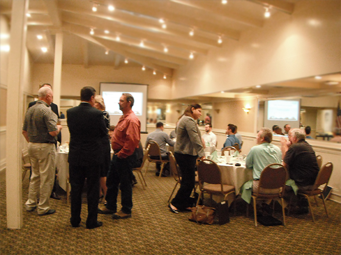 Attendees mingling prior to the start of the Quarterly Meeting.