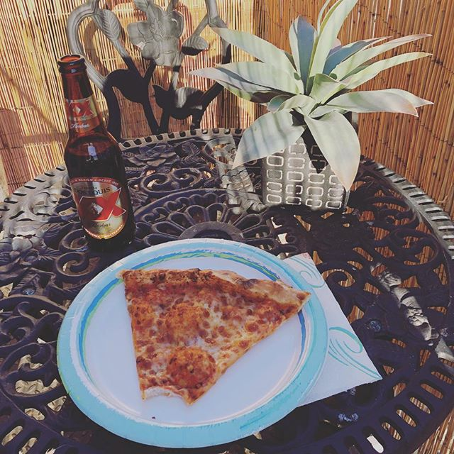 Enjoying the new patio decor the only way I know how! 🍕🍺#feelslikespring #noda #clt #silvercraftstudios