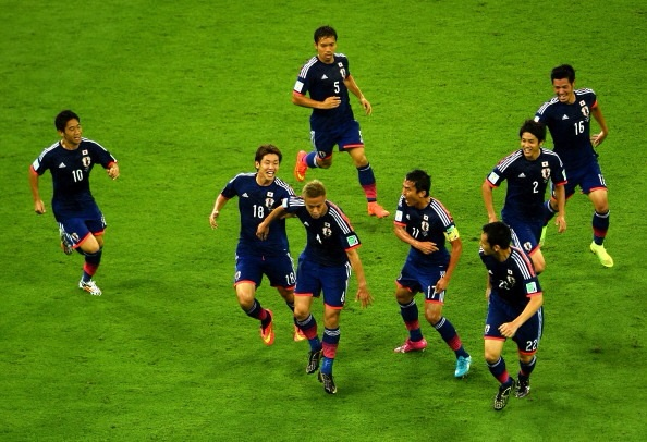 And it started so well. Japan celebrates Honda's goal against Cote D'Ivoire