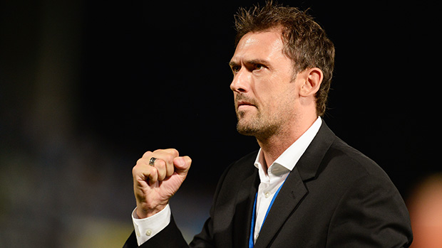Bossin' it. Tony Popovic celebrates a famous win.