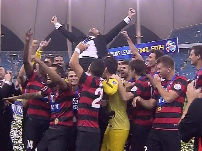 Shout it out loud. Tony Popovic and his players celebrate.