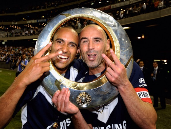 Up Yours, we're movin'..    Archie Thompson and Kevin Muscat getting in the ring.