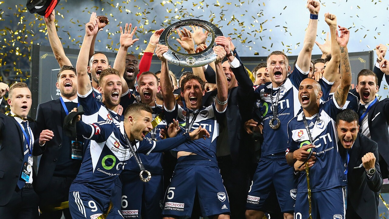 Lords of Ring.  Melbourne Victory with last year's prize.