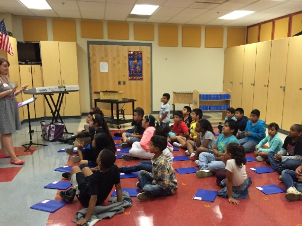 Oberle Neighborhood Choir students practicing songs and musicianship skills    with their director, Nicolette Fernandez.