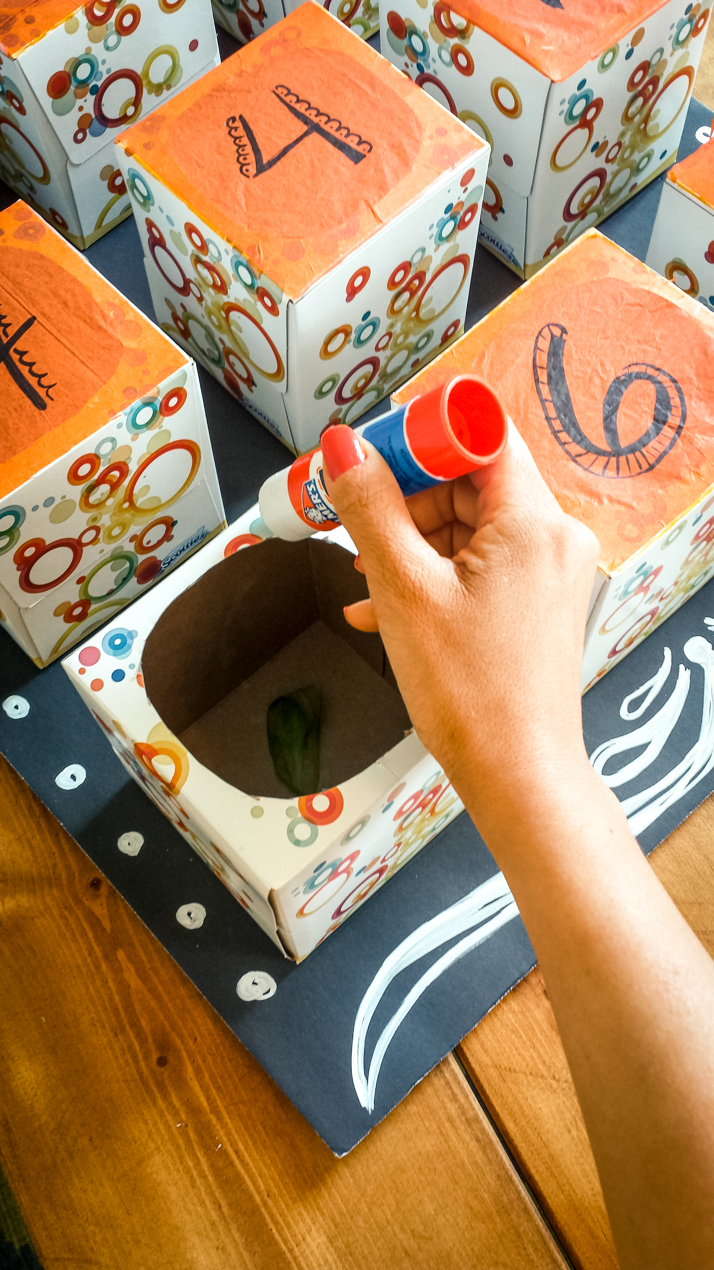 Take your glue stick and add a generous amount to the top of the kleenex box.