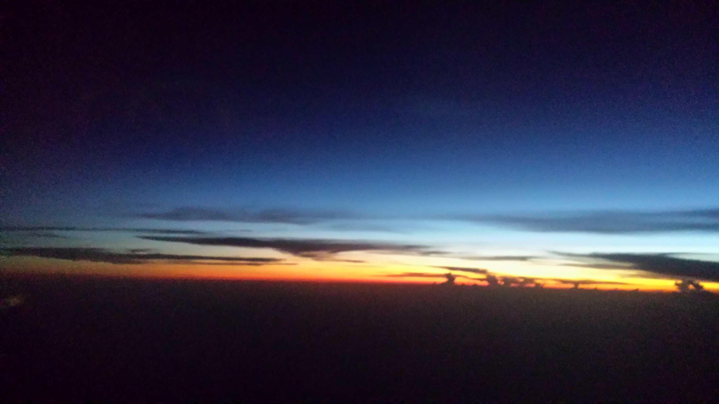Sunset viewing through an airplane window...en route to Nicaragua.