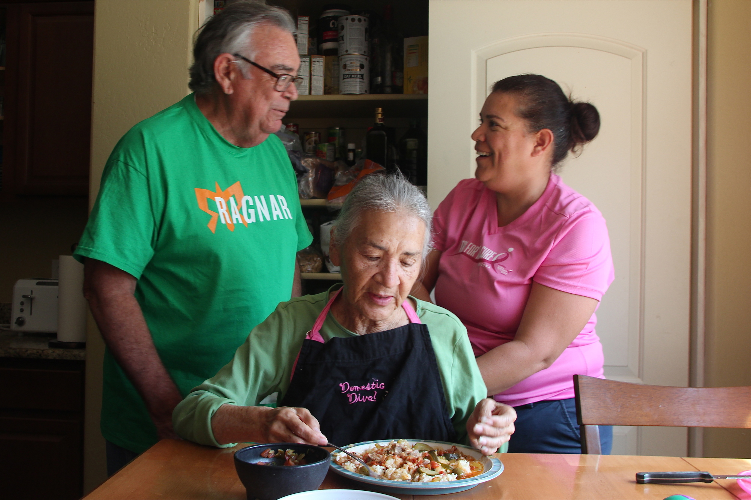 Roland and Leonor sit Gladys down for lunch at Leonor's house in Marana, Ariz. © Nigar Fatali
