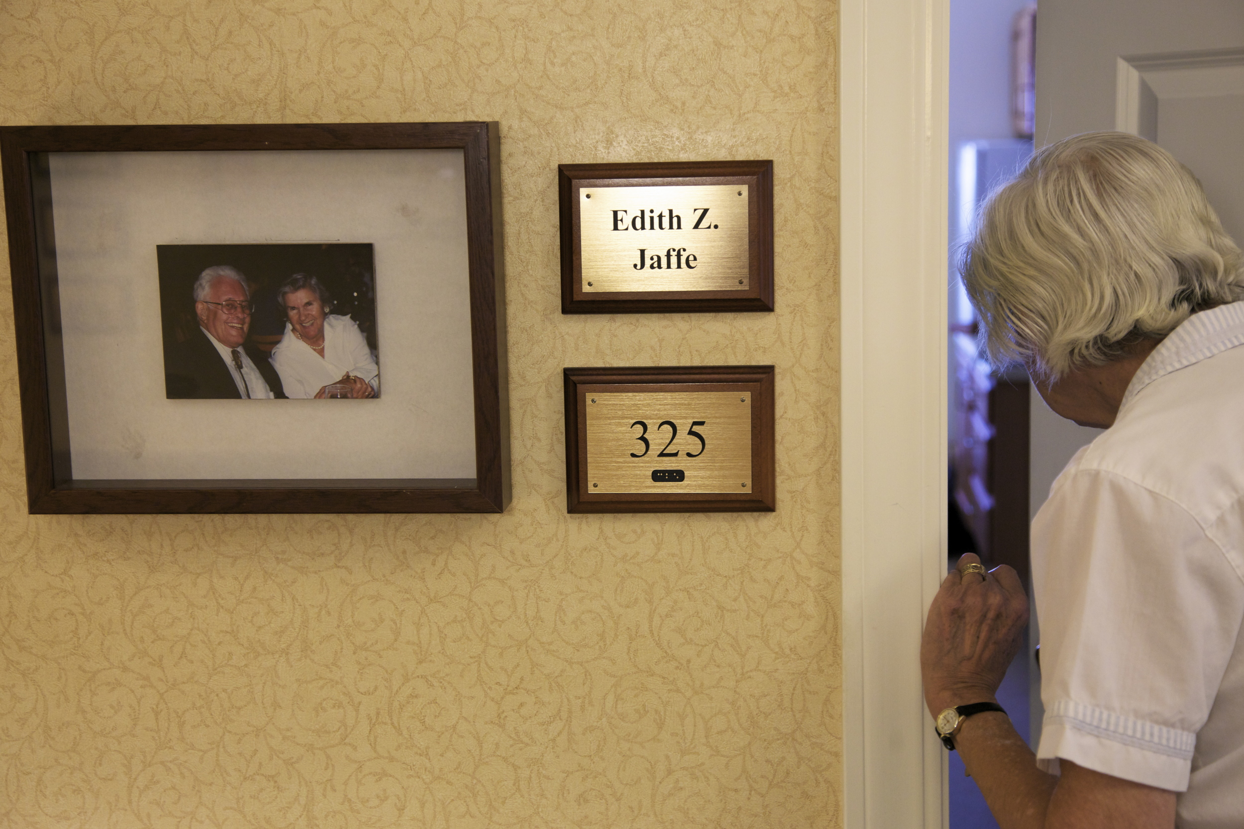 Patients at the assisted living facility  have their pictures and names next to their room. The precaution keeps them from wandering away. © Nigar Fatali
