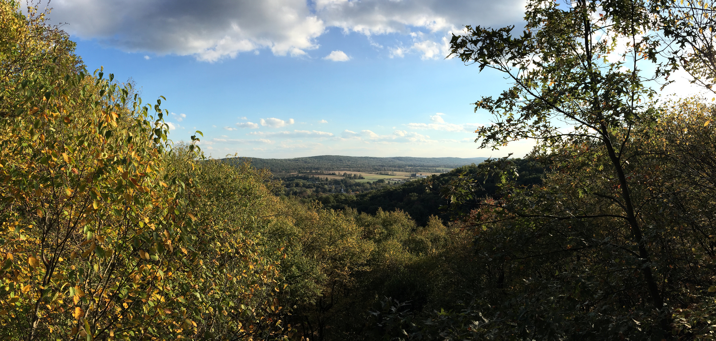 A panoramic shot I took on 10/8 from the top of the mountain, overlooking miles of farmland and trees.