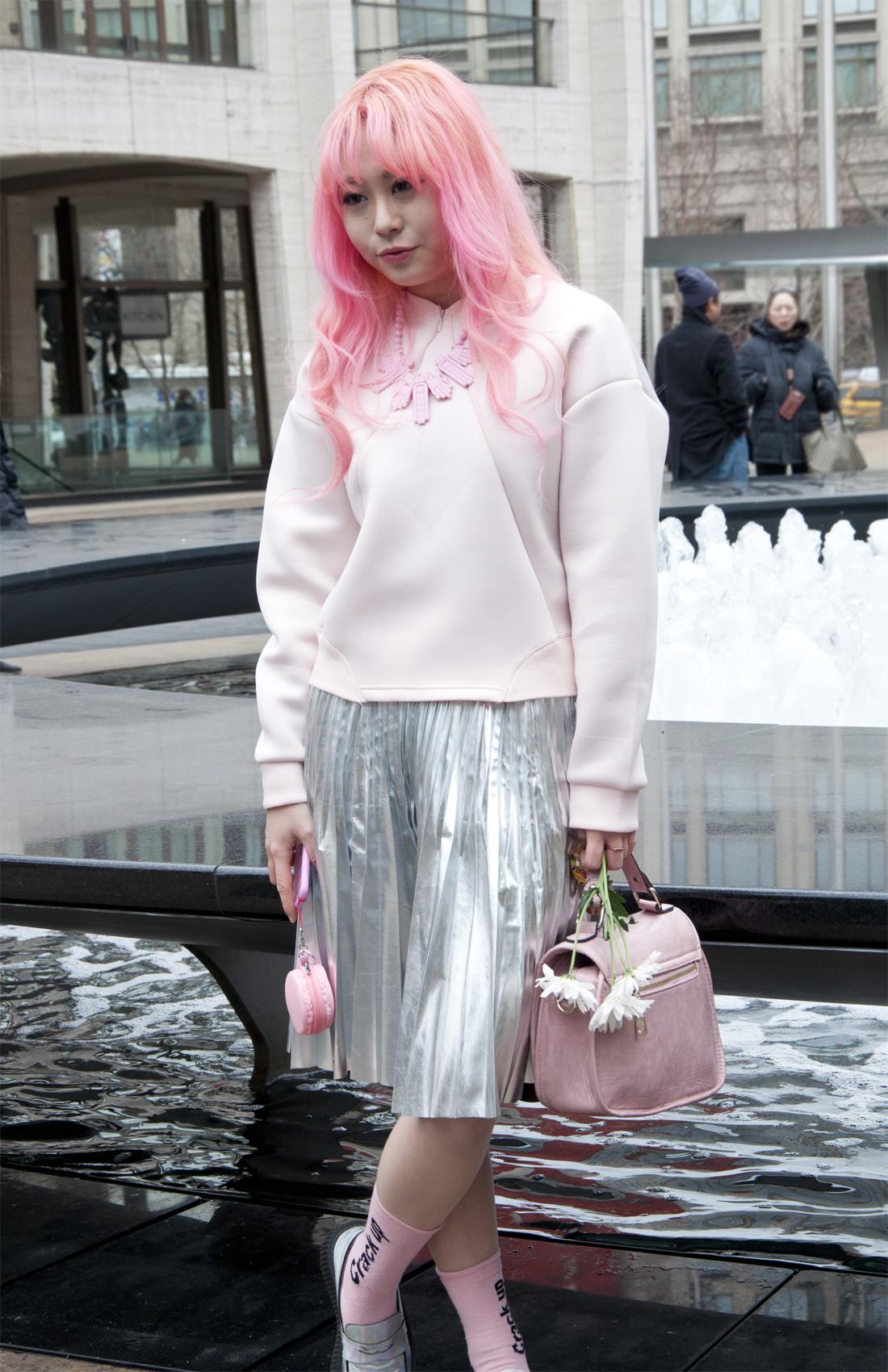 Eun Bi wearing ROCKET X LUNCH (sweatshirt + skirt), visiting from Korea for her first NYFW