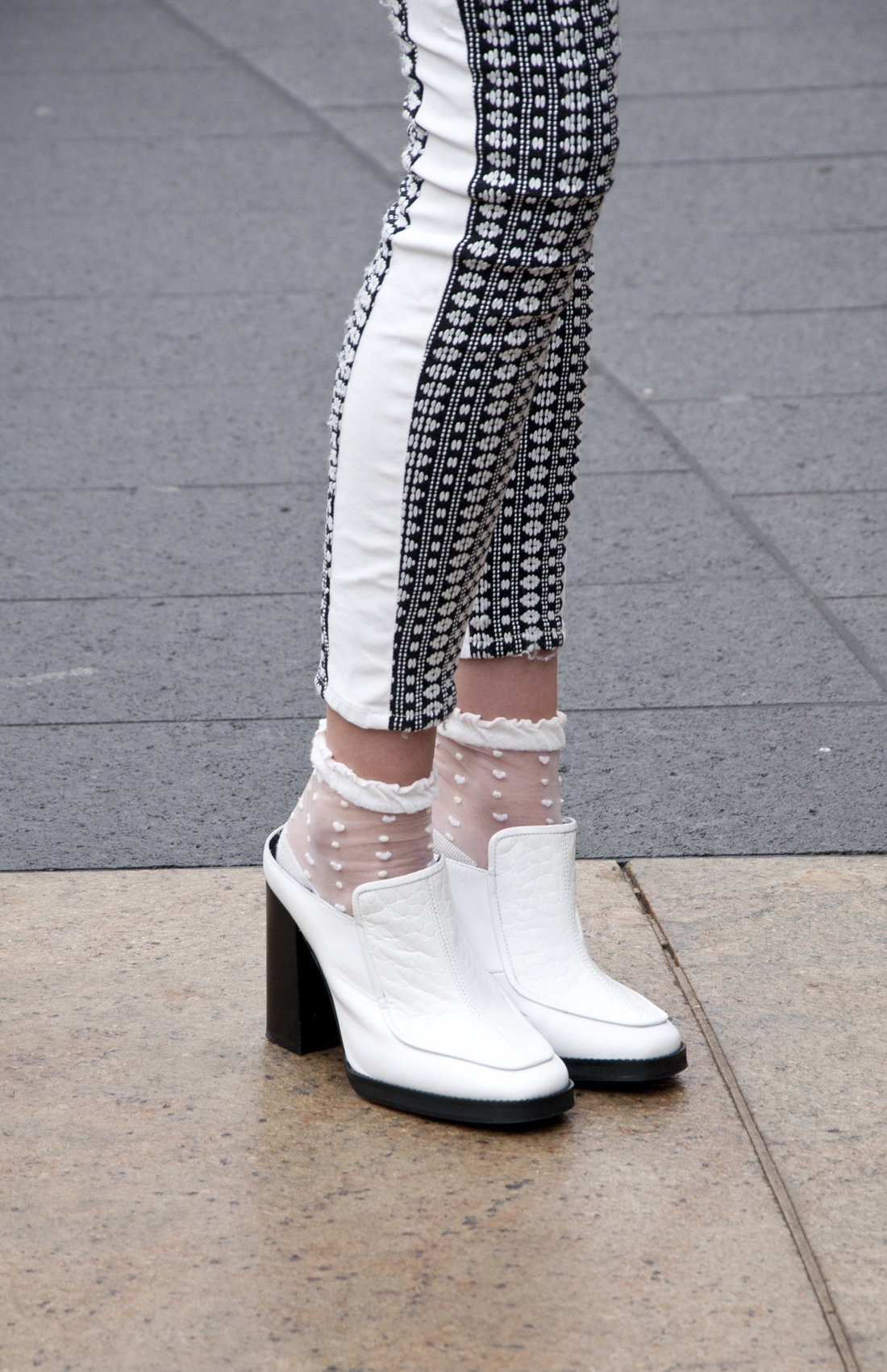 Sammy Riley  wearing shoes by Topshop and jeans by 7 For All Mankind