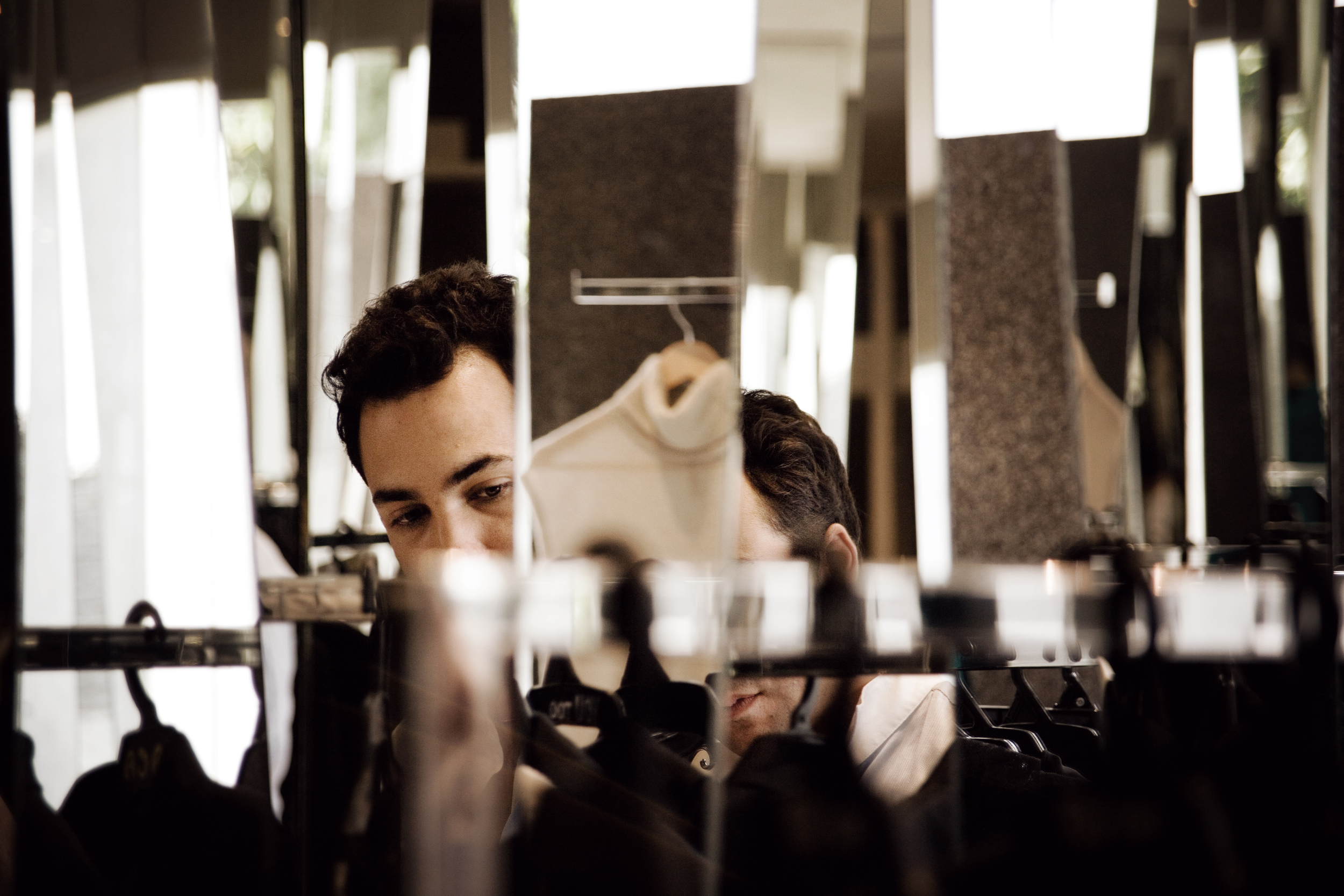 Picture of the designer at his showroom in Monterrey.