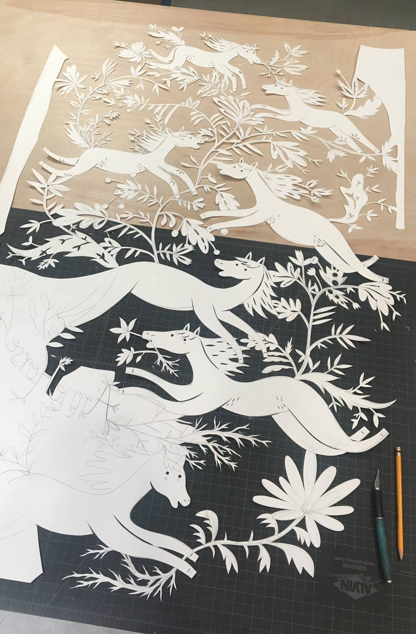 Work in progress  - single sheet of paper is cut with an exacto blade. Lines and silhouettes are drawn with a knife