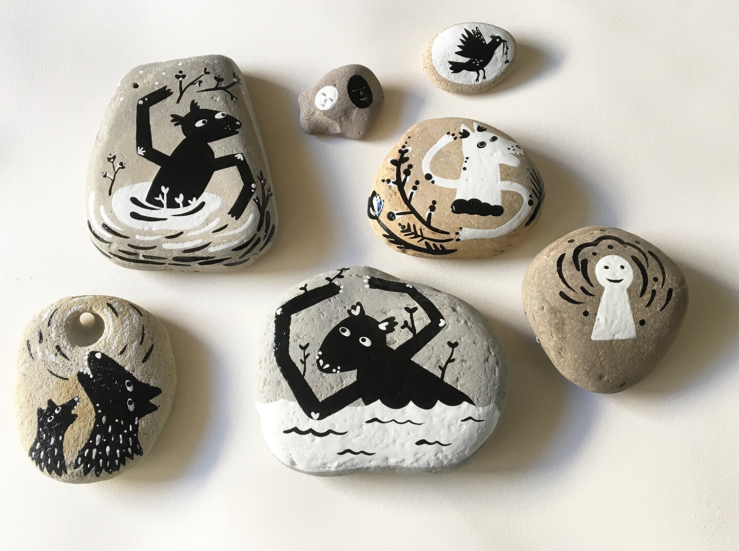 Protection Stones  - 2019, sign painter's enamel on beach rocks, various sizes - private collection - some available on  superhumanspirit.com