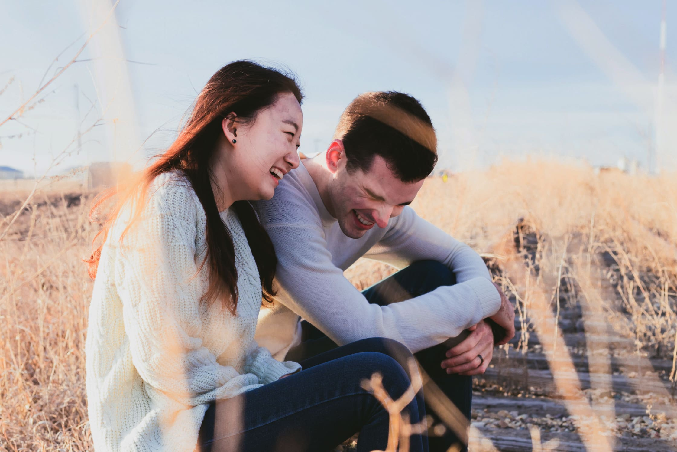 couple-laughing-together-outside-during-fall-winter.jpg