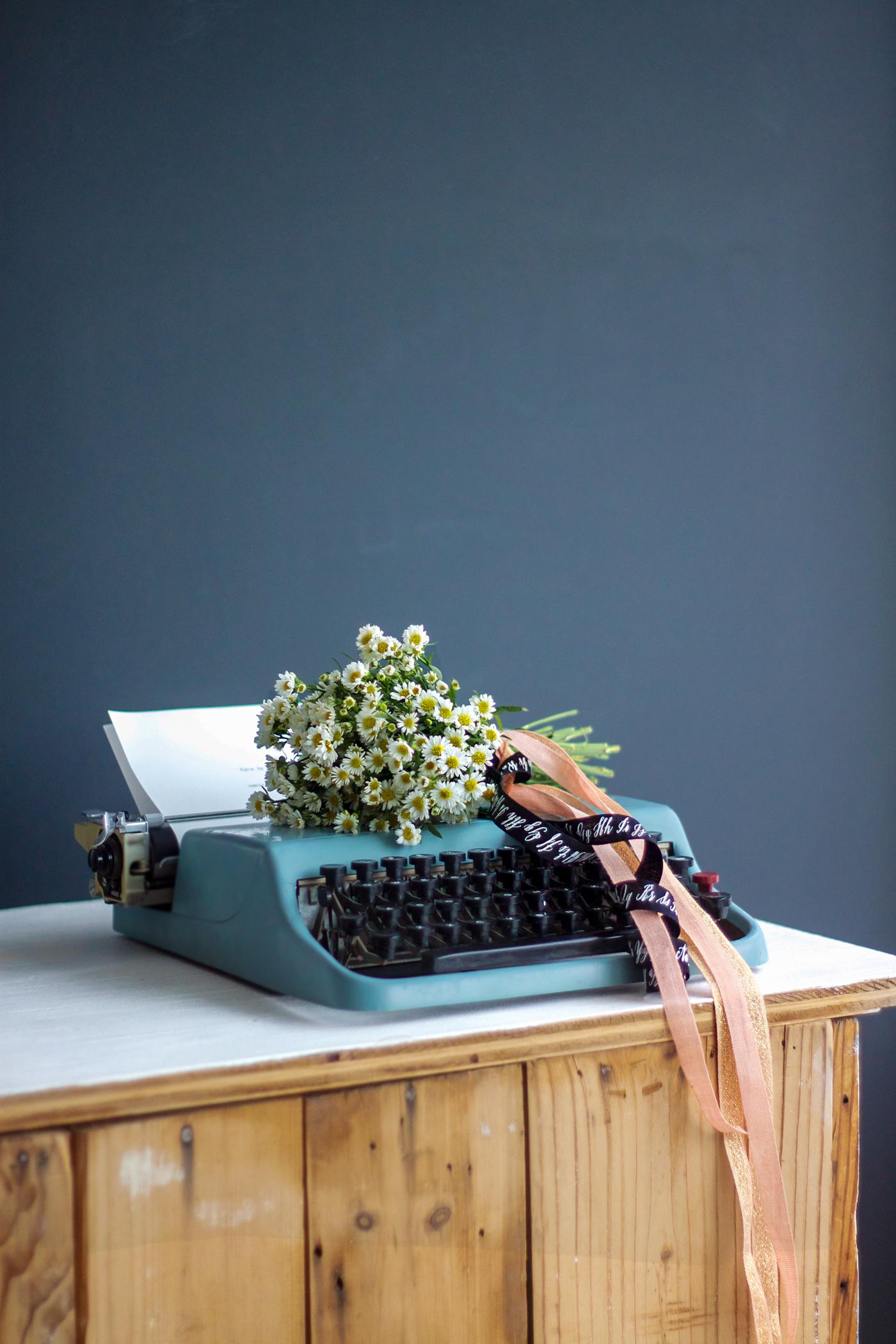 White aster bouquet with Studio Carta ribbon, typewriter, by Justine Hand_edited-1.jpg