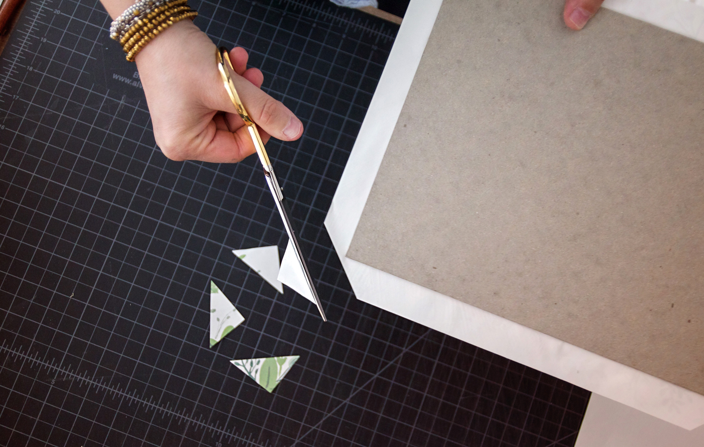 Step 3: Cut the corners of your paper, leaving about a millimeter between the edge and the cardboard.