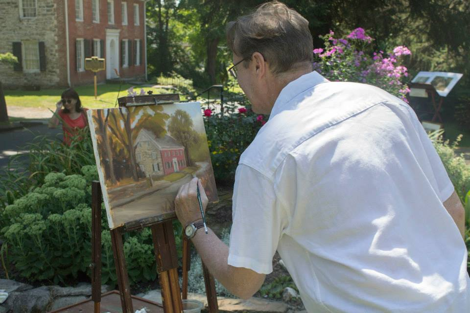 Kevin Cook painting the 1799 House during Artists on the Street, 2014
