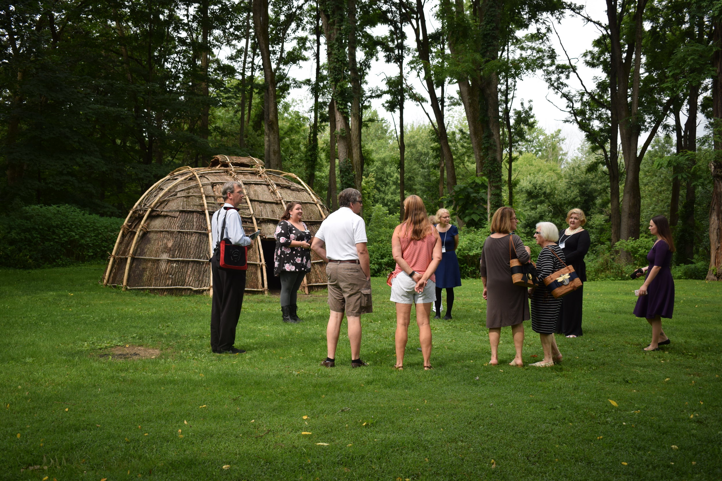 """Guests on the """"In Her Words"""" Women's History Tour in front of the wigwam"""