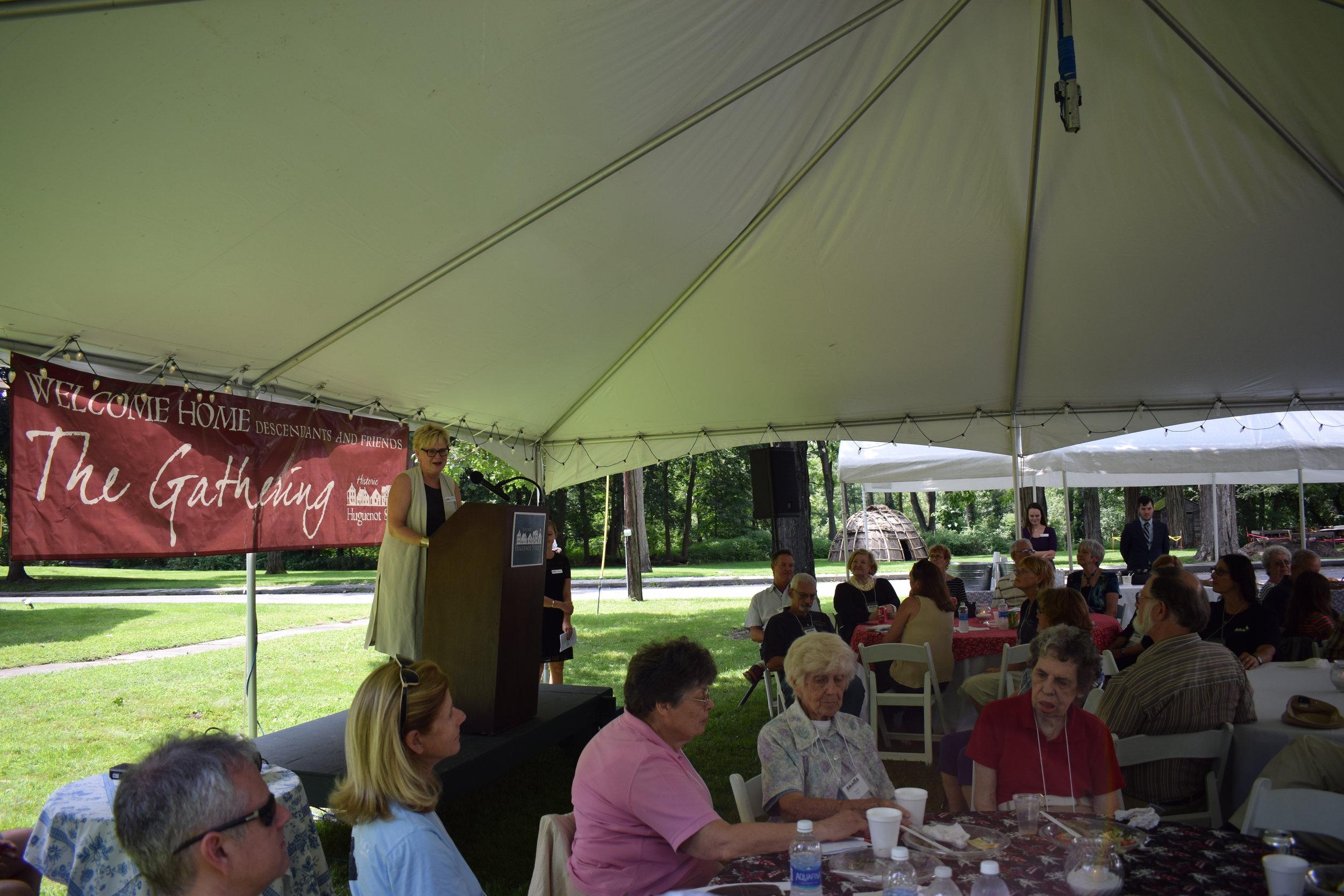 Board Chair Mary Etta Schneider speaks at lunch