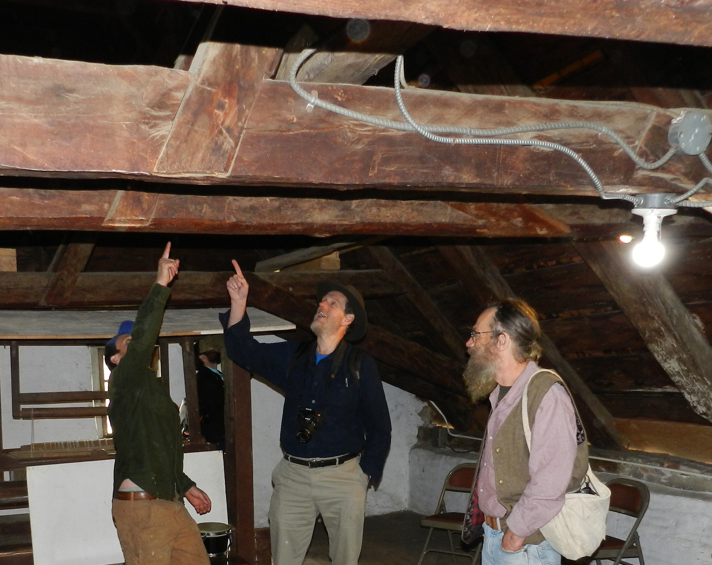 Members of the Traditional Timber Frame Research and Advisory Group (TTRAG) examine timber framing in the attic of the Jean Hasbrouck House, 2017.