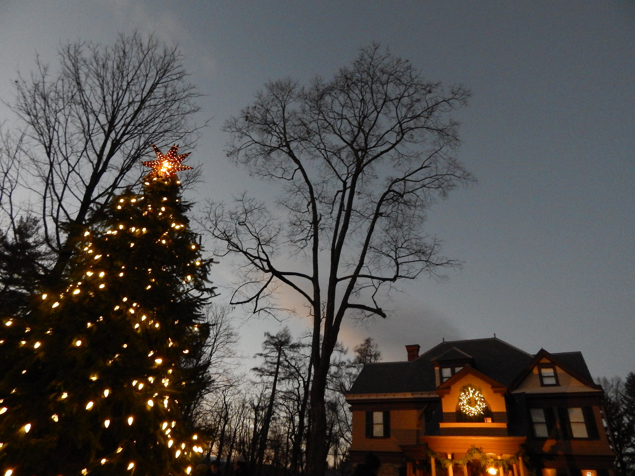 Community Tree Lighting in front of the historic Deyo House
