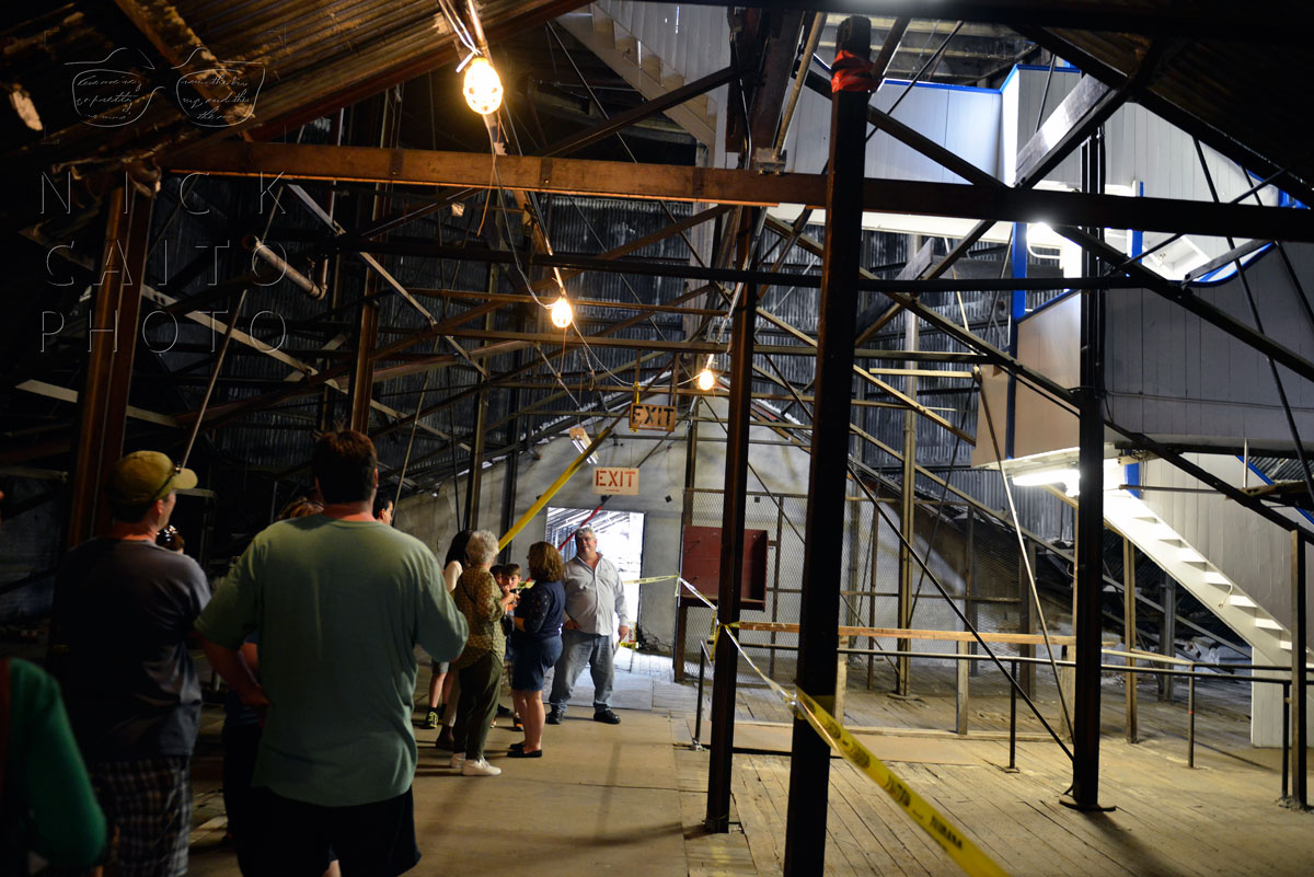 "Going through the ""attic"" of the Colt Building. The area is normally off limits. Stairs going to the dome at right."