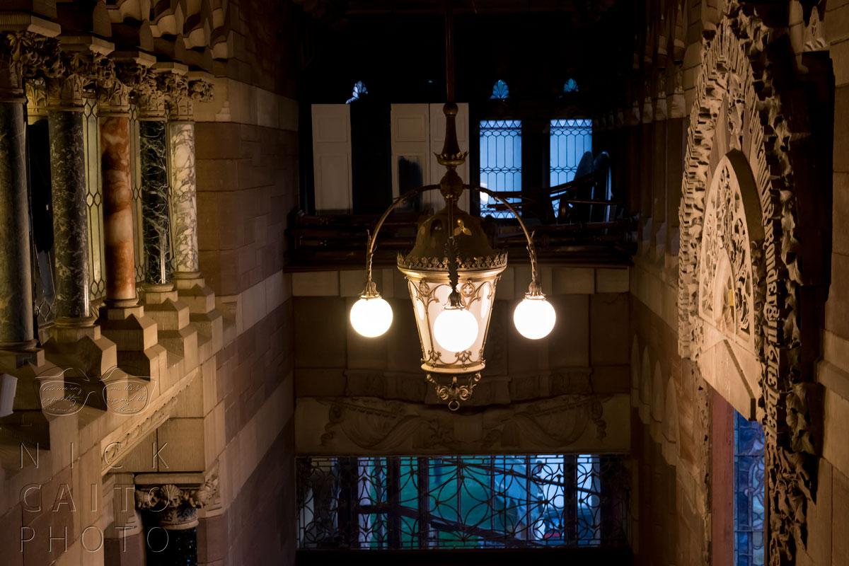 Beautiful light fixtures, marble pillars.