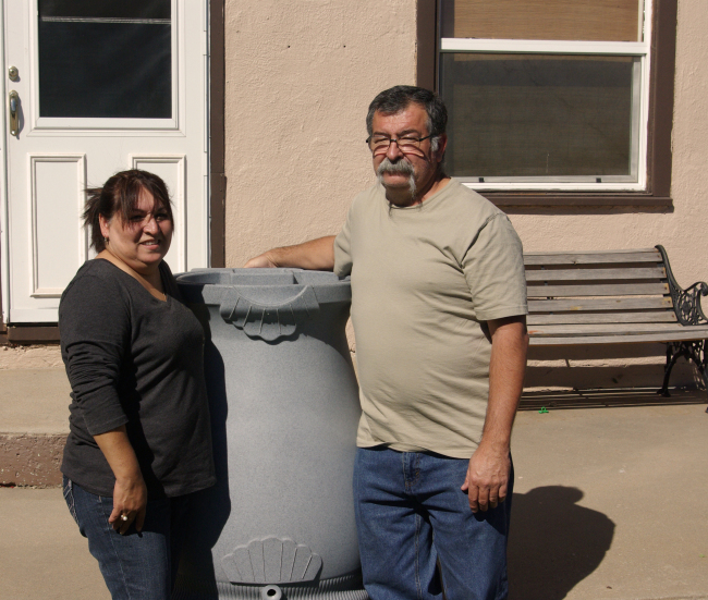 Pictured: Mr. & Mrs. Martinez with their rain barrel.