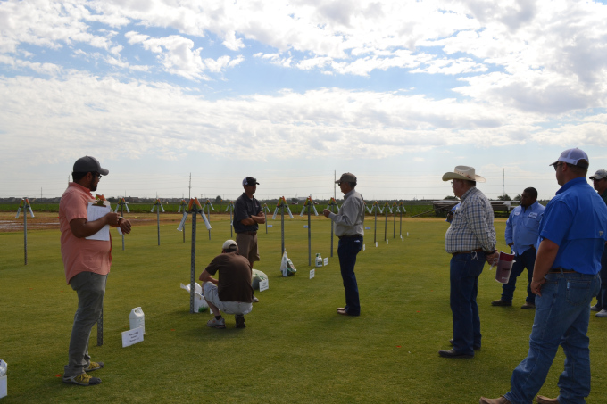 Left to right: Vikrim Baliga and Joey Young talking to the homeowners group about various residential wetting agents.