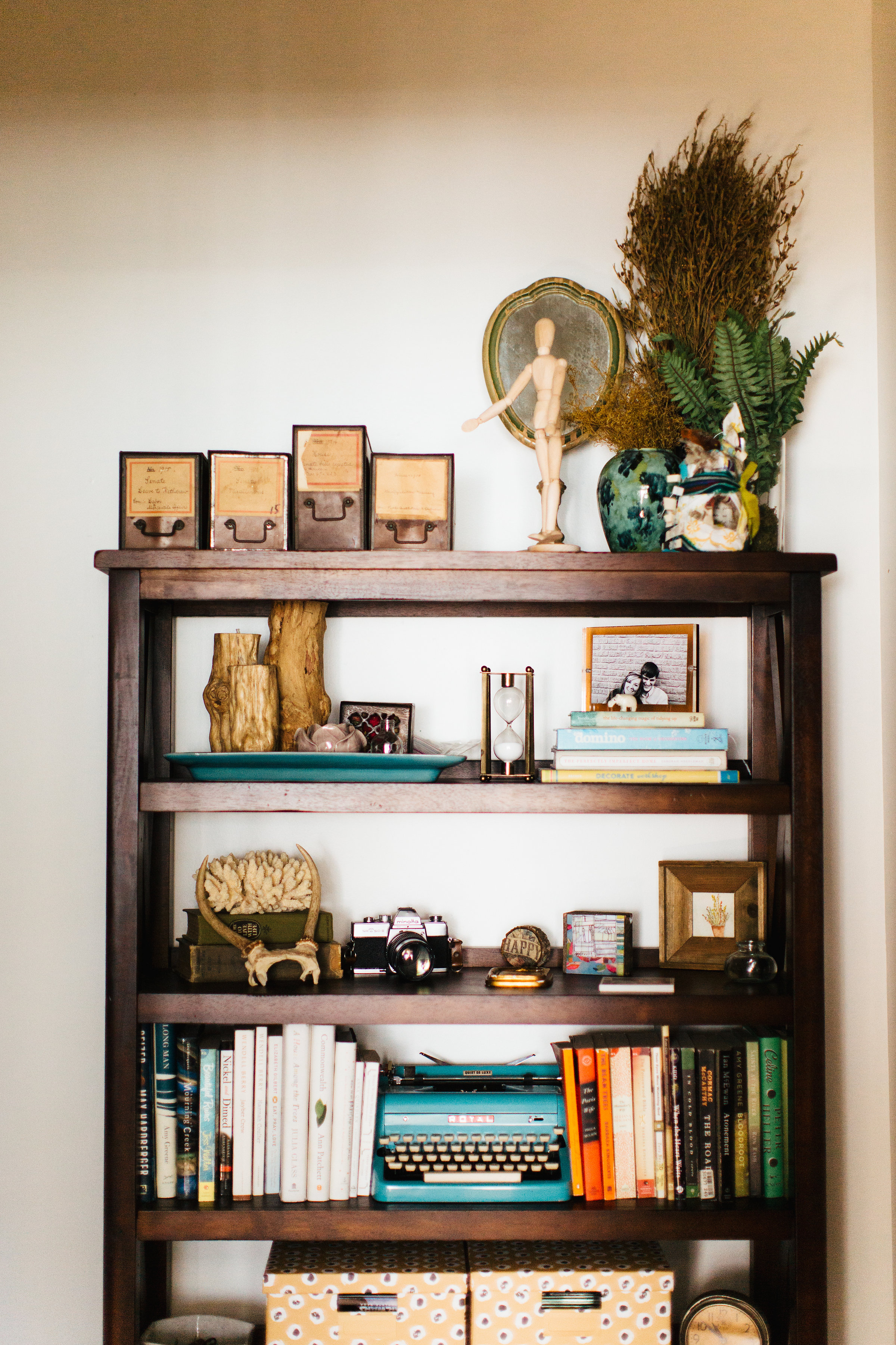 Bookshelf of collected treasures, photo by Texture Photo.