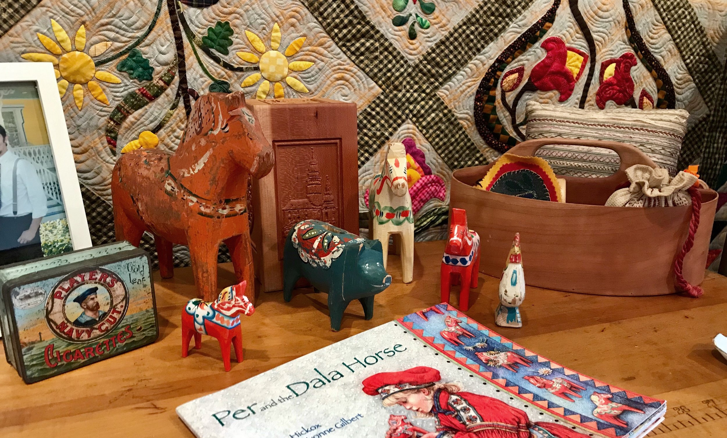 A collection of Dala horses and other treasures from Sweden passed down from Carl's side of the family