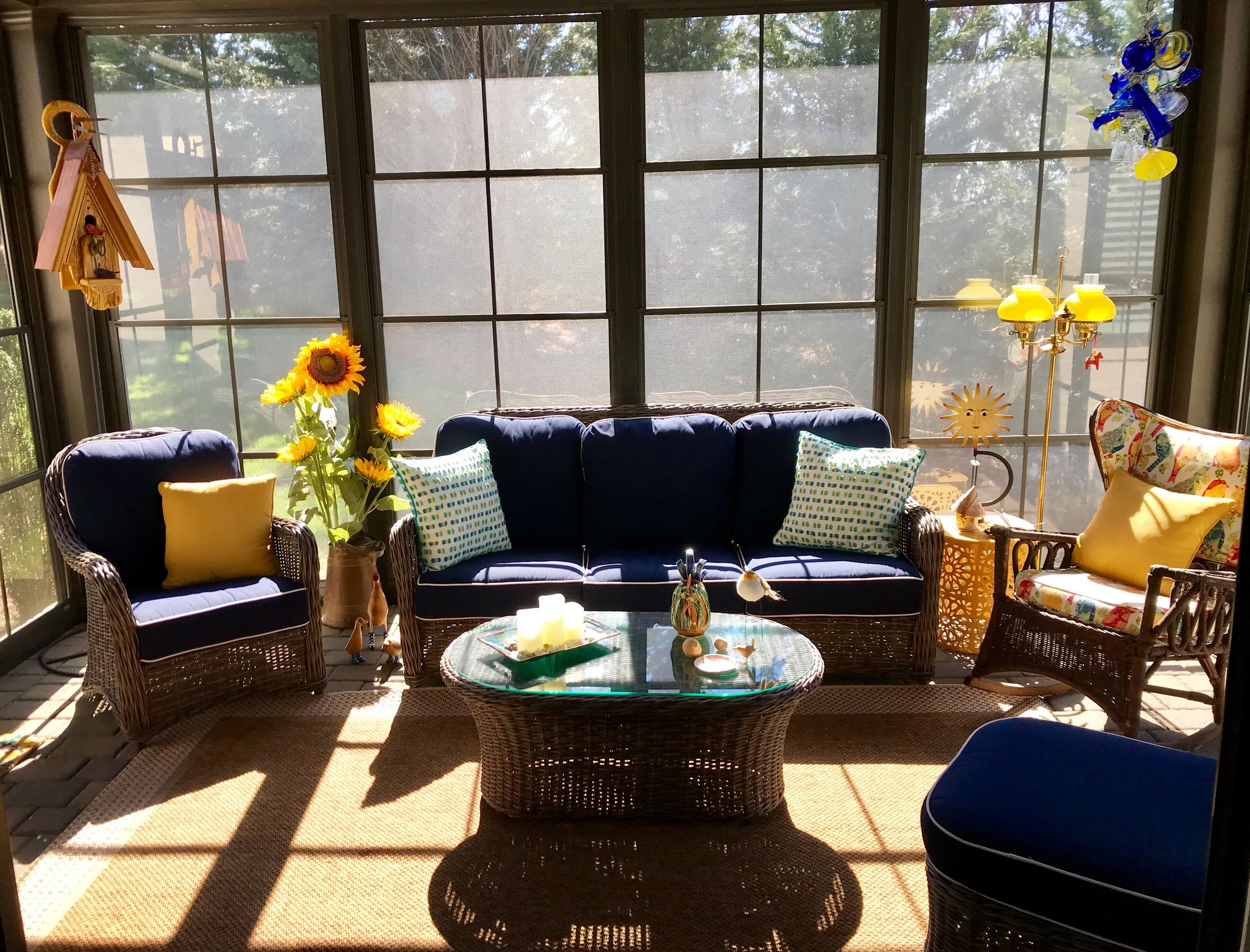 A wonderful sun room that Susie converted from a screened in porch to be able to use year round.