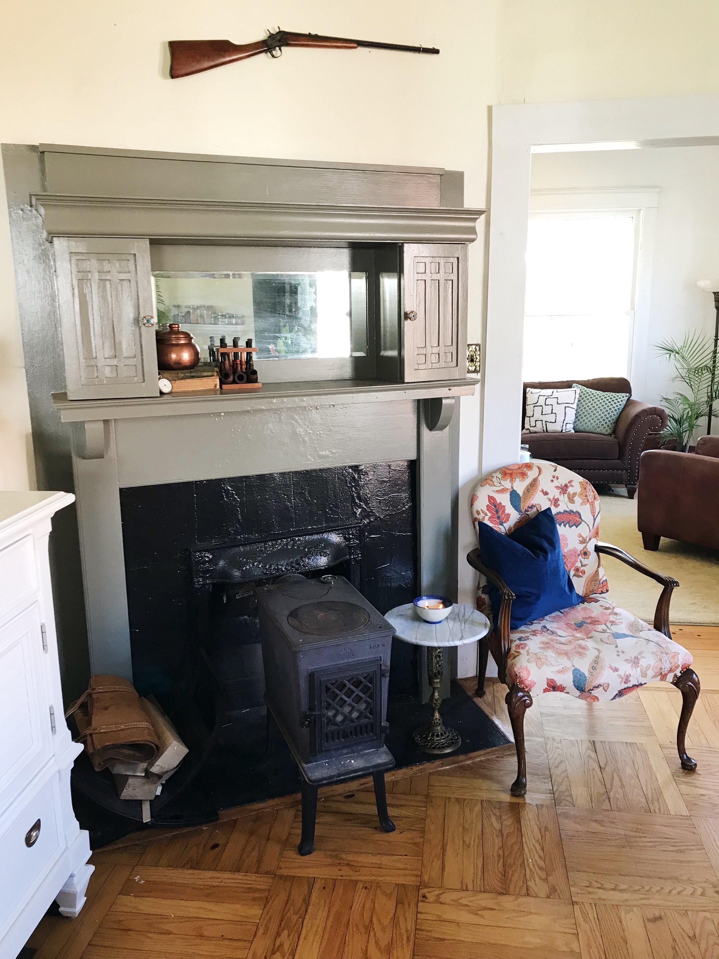 Dining room- original fireplace.