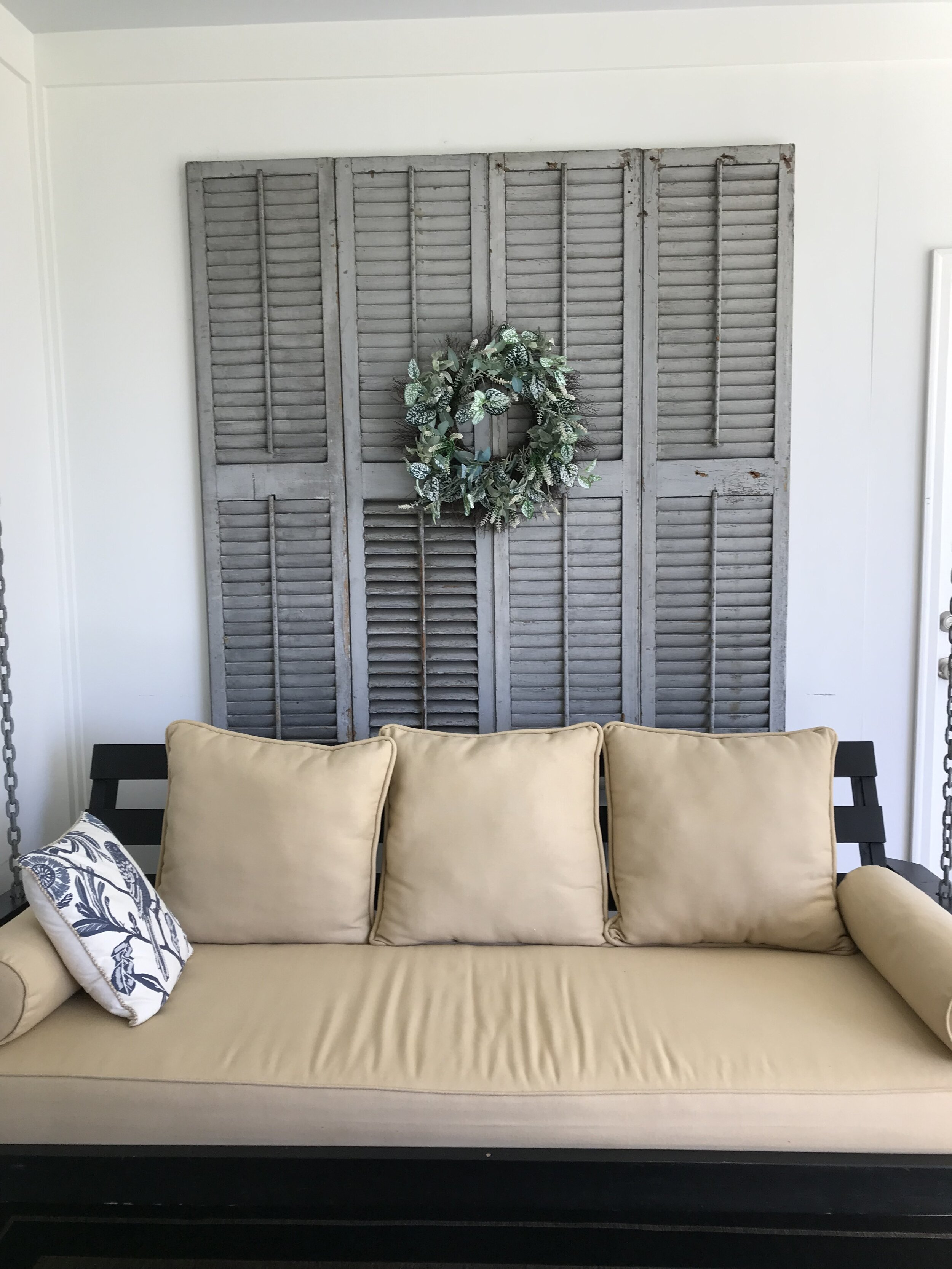 Shutters repurposed as decor. We love the texture these add to the space.