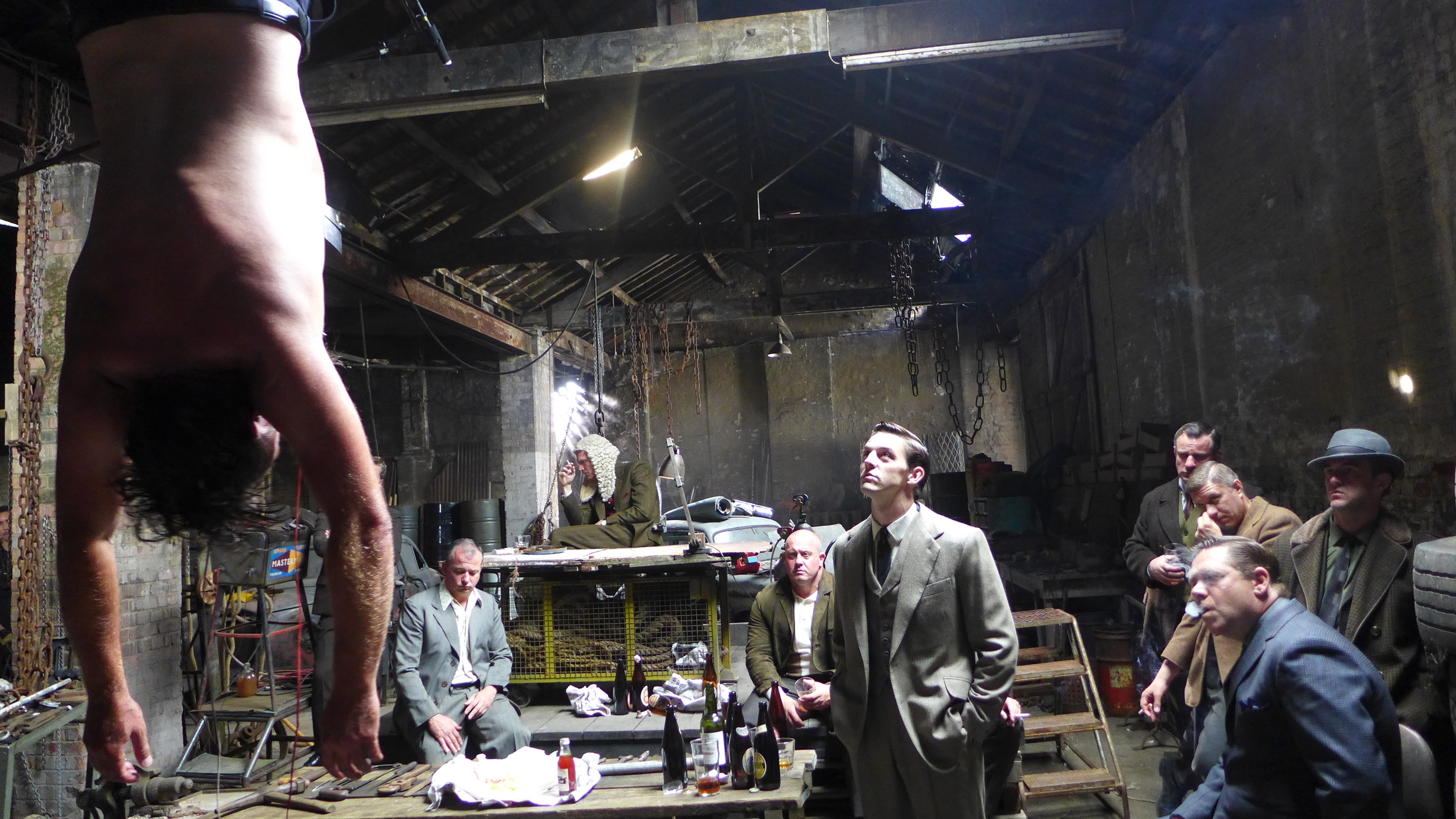 Legend. The Richardson's Scrap Yard. Production Design Tom Conroy. Set Decoration Crispian Sallis.