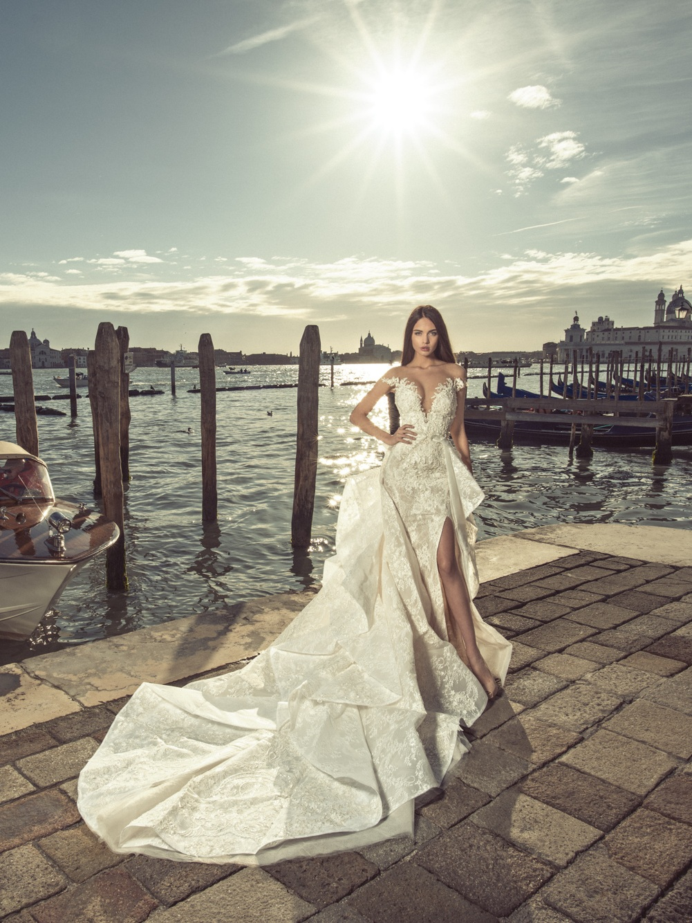 Venice 08 - Fitted two piece lace wedding gown with an illusion off the shoulder neckline and complete low illusion back. Features a pearl embellished plunge neckline with option of detachable textured train.