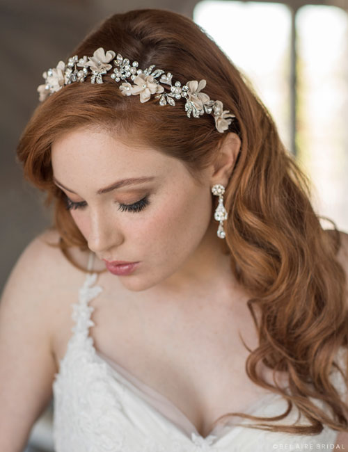6677   Headband of flowers with rhinestone and pearl accents