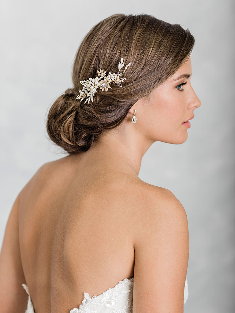 6931   Petite comb of pearl flowers accented with opal crystals and rhinestones