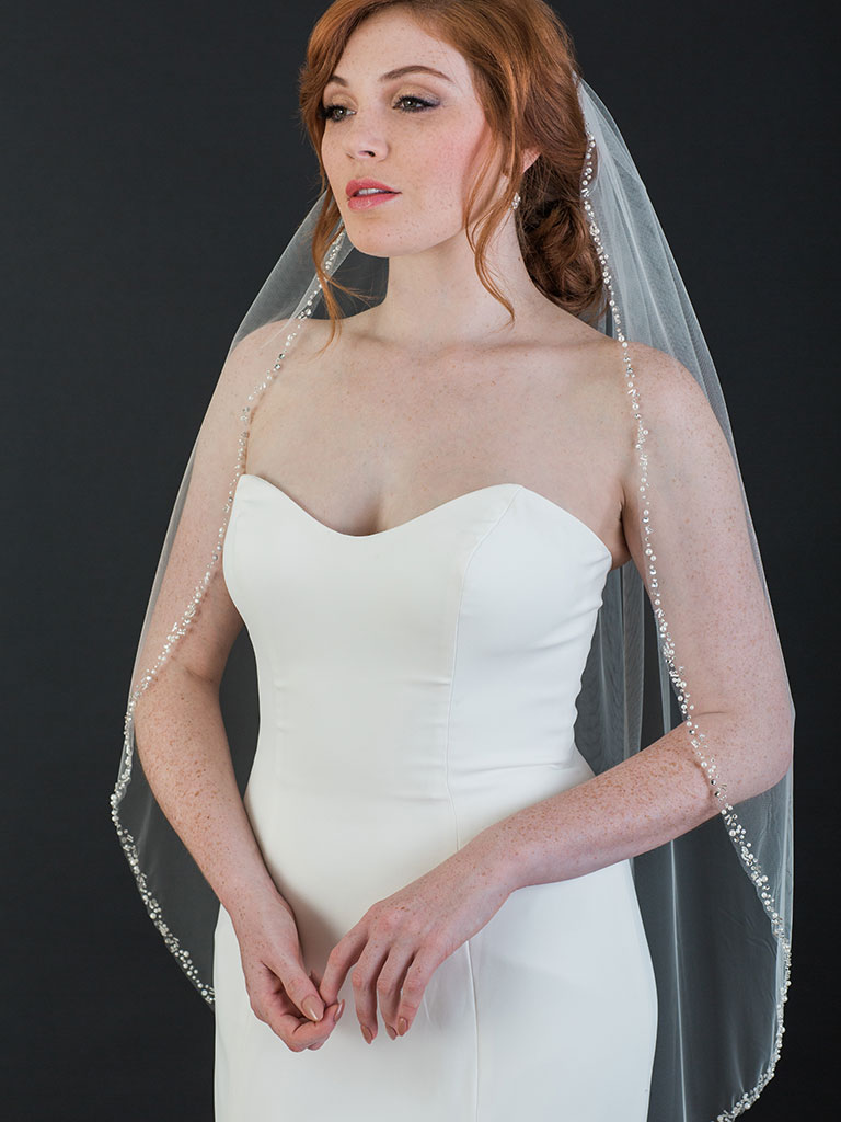 V7451   1-tier fingertip veil with edge of rhinestones, pearls, and bugle beads