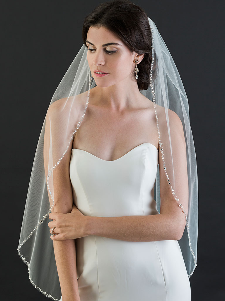 V7456   1-tier fingertip veil with narrow edge of pearls, beads, and rhinestones